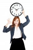 Asian Businesswoman Show Ok Sign With Clock Over Head