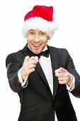Half-length portrait of businessman wearing Santa Claus cap, isolated on white. Concept of holidays and Christmas