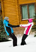 Couple joins their hands while having fun during winter holidays