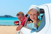 Little Boy And His Father In A Car On The Beach