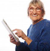 Senior happy woman using ipad isolated on white background