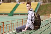 Handsome Young Smiling Man With Backpack