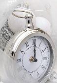 stock photo of pendulum clock  - silver clock retro style overlooking midnight with chrsitmas balls - JPG
