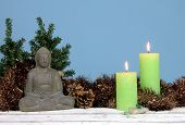 Buddha statue, tinsels and candles