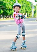 Little girl on roller skates at park