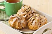 picture of eclairs  - Tasty eclairs on table with tea cup - JPG
