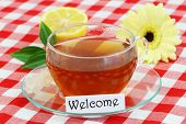 Welcome card with cup of tea, lemon and gerbera daisy