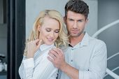 Close Up Romantic Middle Age Partners in White Long Sleeves Attire for Fashion Shoot.