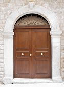 Wooden frontdoor with marble frame.