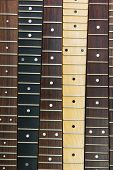 Six guitar necks aligned, Rosewood, maple and ebony fingerboard necks