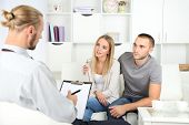 Unhappy couple on couch at therapy session