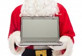 christmas, advertisement, technology, and people concept - close up of santa claus with laptop compu