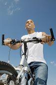 African man riding bicycle