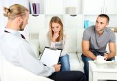 image of not talking  - Unhappy couple not talking on couch at therapy session - JPG