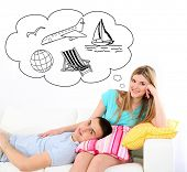 Dreaming concept. Loving couple sitting on sofa, on home interior background