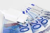 Plug on euro banknotes background