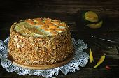 Cake With Almonds; Cream, Cheesecake And Caramelised Mango