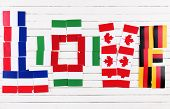 Love word formed with national flags on wooden background