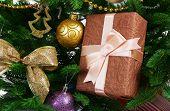 Gift box on Christmas tree closeup
