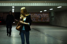 picture of dangerous situation  - Afraid woman in the subway at night