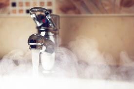 picture of hot water  - water tap with hot water steam - JPG