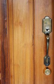 foto of door-handle  - A photograph of an antique door handle on wood door - JPG