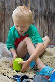 Boy in a sandbox