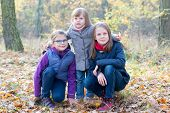 Three Sisters In The Autumnal Forest Smiling