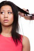 Girl Hairdo With Electric Hair Curler