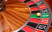stock photo of roulette table  - roulette wheel and the ball in the winning number zero - JPG