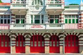 foto of fire-station  - Vintage retro fire station building facade with red gates and brick walls - JPG