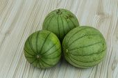 pic of aubergines  - Asian vegetable - round aubergine on the wooden background ** Note: Soft Focus at 100%, best at smaller sizes - JPG