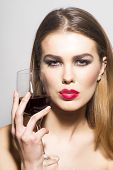 Glamour Girl With Glass Of Red Wine