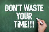 picture of waste management  - Motivational time management note phrase on chalkboard - JPG