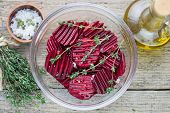 raw beets with olive oil, thyme and sea salt for baking