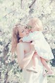 Happy Life Moments Mother Hugging Child In Sunny Spring Flowering Garden