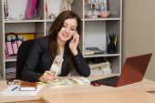 Business Woman Talks By Phone And Counts Money