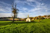stock photo of chapels  - Autumn scene from the Bavarian countryside with a chapel - JPG