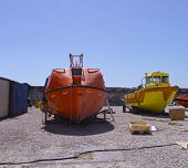 pic of shipyard  - lifeboat and patrol boat in a shipyard - JPG