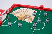 Figures of footbal players on euro banknotes