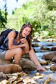 Woman Hiker Splashing Laughing And Water From Stream