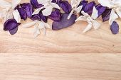 flowers and petals orchids on the background of wooden boards
