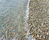 pic of tide  - Sea and the tide lapping on the pebble beach - JPG