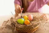 Isolated Shot Of Girl Painting Easter Eggs