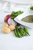 pic of peas  - Mashed peas zucchini onions and potatoes Mashed peas zucchini onions and potatoes on white wooden table - JPG
