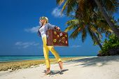 Beautiful Girl With A Vintage Suitcase In A Beach
