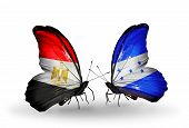 Two Butterflies With Flags On Wings As Symbol Of Relations Egypt And Honduras