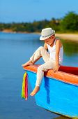 Cute Kid, Boy Sitting On The Bow Of A Boat