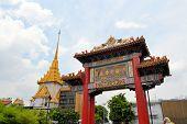 Chinatown gate with Wat Traimit temple, Bangkok, Thailand