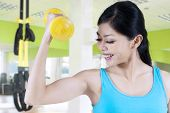Woman Show The Strength Of Her Arm